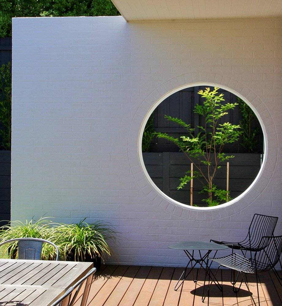 Family home with white brick outdoor feature wall art for photoshoots and filming with Spaces n Places Locations