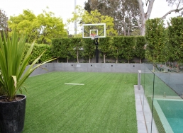 Grass basketball court for filming and photoshoots with Spaces n Places location agency