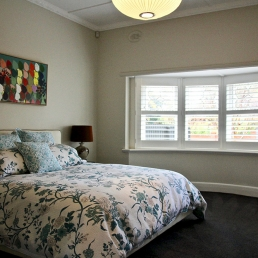 Master bedroom with bay window in California Bungalow for filming and photoshoots with Spaces n Places location agency
