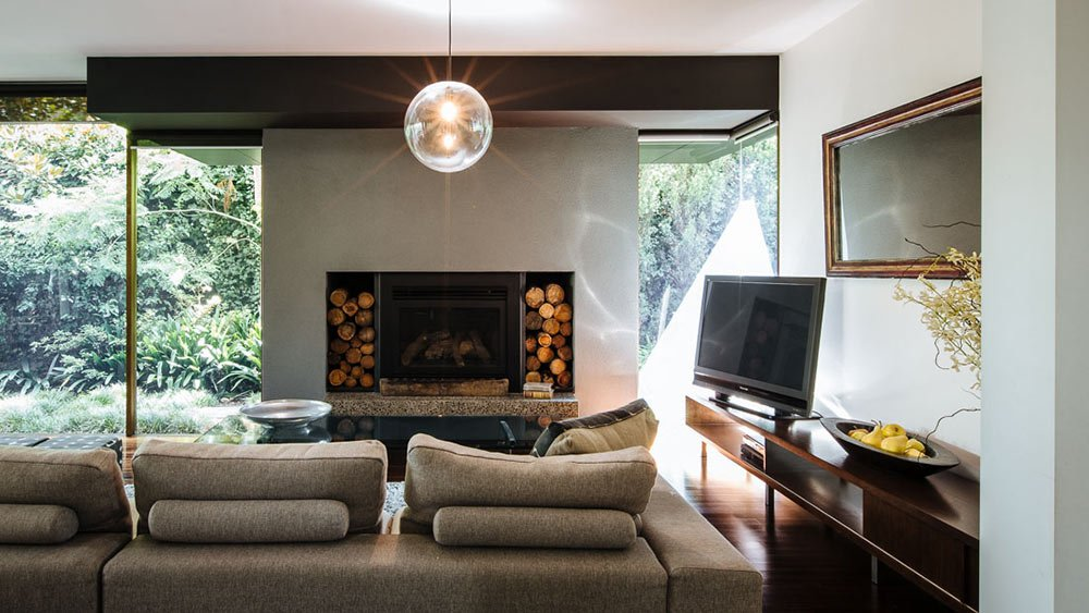 Living area with fire place in family home Bayside Melbourne or photoshoots and filming with Spaces n Places location agency