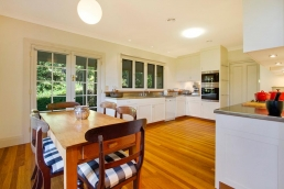 Traditional grand weatherboard house with an opening entrance and hallway. A Spaces n Places location.